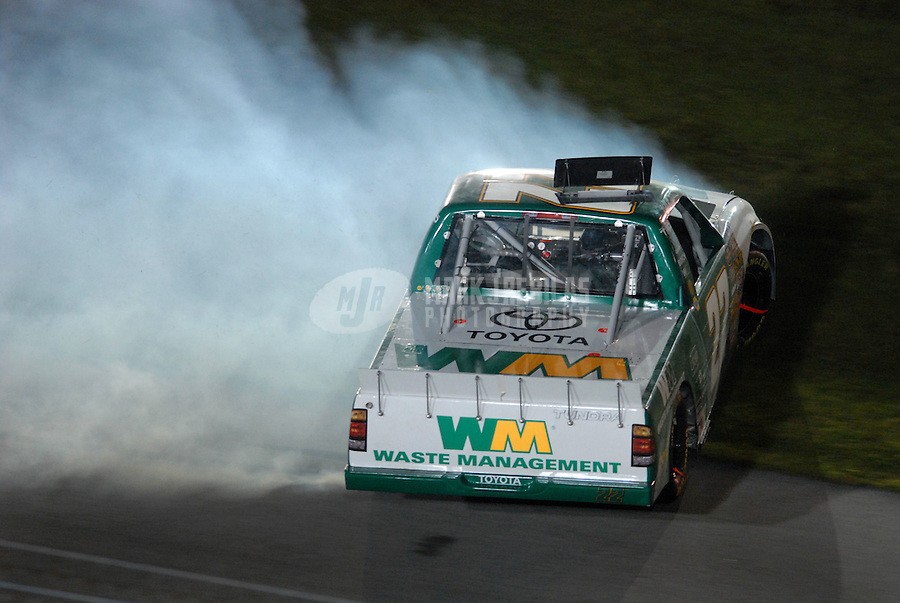 Nov 17, 2006; Homestead, FL, USA; Nascar Craftsman Truck Series driver Bill Lester (22) spins during the Ford 200 at Homestead Miami Speedway. Mandatory Credit: Mark J. Rebilas