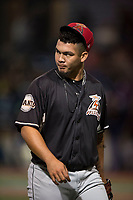 Salem-Keizer Volcanoes relief pitcher Jesus Tona (48) walks off the field between innings of a Northwest League game against the Hillsboro Hops at Ron Tonkin Field on September 1, 2018 in Hillsboro, Oregon. The Salem-Keizer Volcanoes defeated the Hillsboro Hops by a score of 3-1. (Zachary Lucy/Four Seam Images)