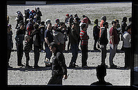 Pictured: Queues of refugees waiting for food Friday 26 February 2016<br />