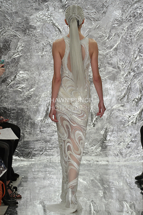 Model Irina Kondratyeva walks runway in Syndulla - a white insterstellar radio wave patterned sequin and 3D paillette bridal gown from, the Theia Spring 2017 bridal collection by Don O'Neill, during New York Bridal Fashion Week Spring Summer 2017 on April 14, 2016.