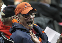 Dick Lawrence shows his excitement during the Virginia game against Maryland Thursday in Charlottesville, VA. Photo/The Daily Progress/Andrew Shurtleff