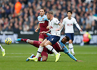 23rd November 2019; London Stadium, London, England; English Premier League Football, West Ham United versus Tottenham Hotspur; Sebastien Haller of West Ham United  challenges Toby Alderweireld of Tottenham Hotspur - Strictly Editorial Use Only. No use with unauthorized audio, video, data, fixture lists, club/league logos or 'live' services. Online in-match use limited to 120 images, no video emulation. No use in betting, games or single club/league/player publications