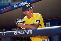 Michigan Wolverines Isaiah Paige (25) in the dugout before a game against Army West Point on February 17, 2018 at Tradition Field in St. Lucie, Florida.  Army defeated Michigan 4-3.  (Mike Janes/Four Seam Images)