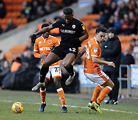 Barnsley's Dimitri Cavare vies for possession with Blackpool's Marc Bola (left) and John O'Sullivan<br /> <br /> Photographer Rich Linley/CameraSport<br /> <br /> The EFL Sky Bet League One - Blackpool v Barnsley - Saturday 22nd December 2018 - Bloomfield Road - Blackpool<br /> <br /> World Copyright &copy; 2018 CameraSport. All rights reserved. 43 Linden Ave. Countesthorpe. Leicester. England. LE8 5PG - Tel: +44 (0) 116 277 4147 - admin@camerasport.com - www.camerasport.com