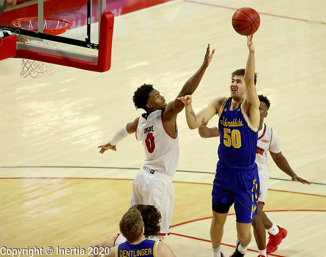VERMILLION, SD - JANUARY 19: David Wingett #50 of South Dakota State Jackrabbits shoots over Stanley Umude #0 of South Dakota Coyotes at the Sanford Coyote Center on January 19, 2020 in Vermillion, South Dakota. (Photo by Dave Eggen/Inertia)