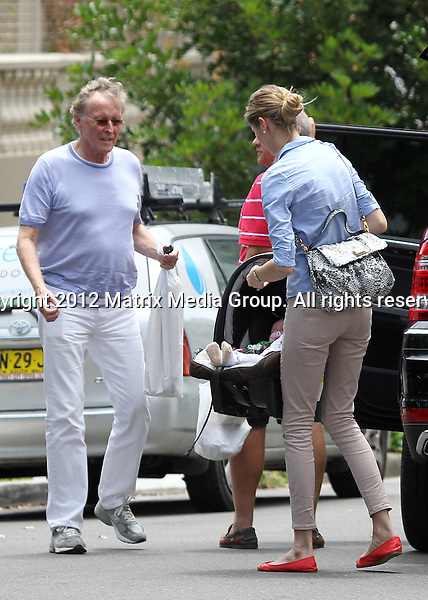 20/1/2012. Sydney, Australia...NON EXCLUSIVE..Model Kristy Hinze arrives home with her husband billionaire Jim Clark, and her parents. Pictured unloading the car with baby in the car capsule.20/1/2012. Sydney, Australia...NON EXCLUSIVE..Model Kristy Hinze arrives home with her husband billionaire Jim Clark, and her parents. Pictured unloading the car with baby in the car capsule...*No internet without clearance*.MUST CALL PRIOR TO USE ..02 9211-1088.Matrix Media Group.Note: All editorial images subject to the following: For editorial use only. Additional clearance required for commercial, wireless, internet or promotional use.Images may not be altered or modified. Matrix Media Group makes no representations or warranties regarding names, trademarks or logos appearing in the images.