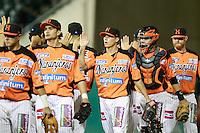 Luis Borquez, Jesse Gutierrez , Jason Urquidez y Jonathan Acevez  festejan triunfo de naranjeros , durante el juego a beisbol de Naranjeros vs Cañeros durante la primera serie de la Liga Mexicana del Pacifico.<br /> 15 octubre 2013