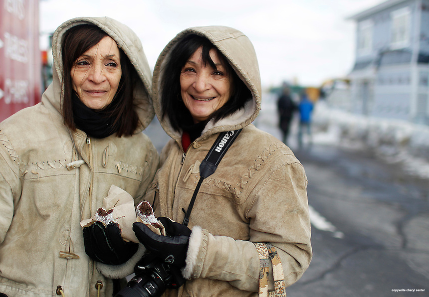 Twins Jean Swanson, left, of Kensington and Grace Carcerano, right, of Napa, CA, at the 12th Annual Penguin Plunge at Hampton Beach, Hampton, N.H., Sunday, Feb. 6, 2011.  (Portsmouth Herald Photo Cheryl Senter)