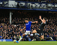 11th January 2020; Goodison Park, Liverpool, Merseyside, England; English Premier League Football, Everton versus Brighton and Hove Albion; Dominic Calvert-Lewin of Everton beats Lewis Dunk of Brighton and Hove Albion to shoot at goal - Strictly Editorial Use Only. No use with unauthorized audio, video, data, fixture lists, club/league logos or 'live' services. Online in-match use limited to 120 images, no video emulation. No use in betting, games or single club/league/player publications
