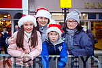 Waiting for Santa at CH Chemist Christmas Parade Tralee on Saturday were Ciara O'Regan, Leanne O Regan, Niall O'Regan, Catriona O'Regan