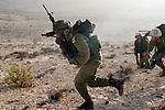 Israeli infantry soldiers are seen during a training exercise with live ammunition and real-life simulations in the desert area in southern Israel, early Thursday morning, June 18, 2009. Photo By: Eliyahu Ben Yigal / JINI..