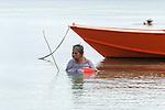 Elderly woman fishing in Funafuti, Tuvalu