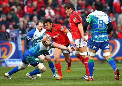 23.03.2013 Cork, Ireland. Casey Laulala (Munster) in action against Andrew Browne (Connacht), during the Rabodirect Pro 12 game between Munster and Connacht from Musgrave Park.