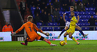 Oldham Athletic's Eoin Doyle (C) has a shot at goal despite the attentions of AFC Wimbledon's George Francomb (R)during the Sky Bet League 1 match between Oldham Athletic and AFC Wimbledon at Boundary Park, Oldham, England on 21 November 2017. Photo by Juel Miah/PRiME Media Images
