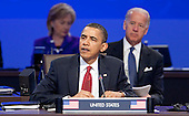 United States President Barack Obama speaks during the opening plenary session with  U.S. Vice President Joseph Biden, right, and Hillary Clinton, U.S. secretary of state, during the Nuclear Security Summit at the Washington Convention Center in Washington, D.C., U.S., on Tuesday, April 13, 2010. Ukraine's agreement to relinquish its entire stockpile of highly enriched uranium gave Obama the first concrete result for a summit he convened on securing the world's atomic material. .Credit: Andrew Harrer / Pool via CNP