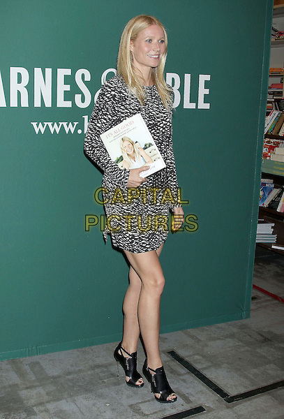 """Gwyneth Paltrow.Gwyneth Paltrow's """"It's All Good: Delicious, Easy Recipes that Will Make You Look Good and Feel Great"""" Book Signing held at Barnes & Noble The Grove, Los Angeles, California, USA..April 3rd, 2013.full length dress black white pattern print ankle boots open toe belted .CAP/ADM/RE.©Russ Elliot/AdMedia/Capital Pictures."""