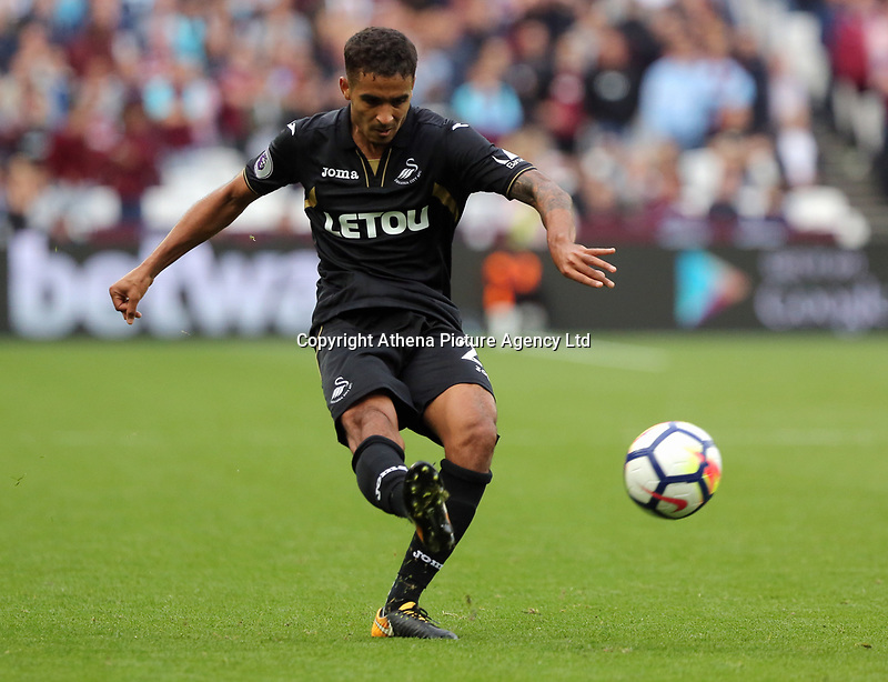 Kyle Naughton of Swansea City takes a cross during the Premier League match between West Ham United v Swansea City at the London Stadium, London, England, UK. Saturday 30 September 2017