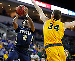 SIOUX FALLS, SD - MARCH 8: Deondre Burns #2 of the Oral Roberts Golden Eagles takes the ball to the basket against Rocky Kreuser #34 of the North Dakota State Bison at the 2020 Summit League Basketball Championship in Sioux Falls, SD. (Photo by Richard Carlson/Inertia)