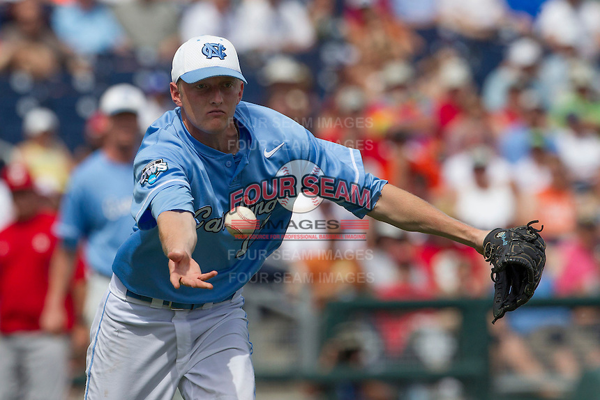 North Carolina pitcher Chris McCue (17) tosses the ball to first base during Game 3 of the 2013 Men's College World Series against the North Carolina State Wolfpack at TD Ameritrade Park on June 16, 2013 in Omaha, Nebraska. The Wolfpack defeated the Tar Heels 8-1. (Andrew Woolley/Four Seam Images)