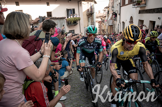Primoz Roglic (SVK/Jumbo-Visma) & Rafal Majka (POL/Bora-Hansgrohe) side by side up the steep, cobbled & crowded climb in Pinerolo<br /> <br /> Stage 12: Cuneo to Pinerolo (158km)<br /> 102nd Giro d'Italia 2019<br /> <br /> ©kramon