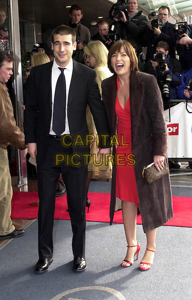 DAVINA MCCALL & HUSBAND MATTHEW.at the Pride Of Britain Awards, Hilton Hotel.red shoes, louis vuitton handbag.photographers, press, paparazzi.www.capitalpictures.com.sales@capitalpictures.com.© Capital Pictures