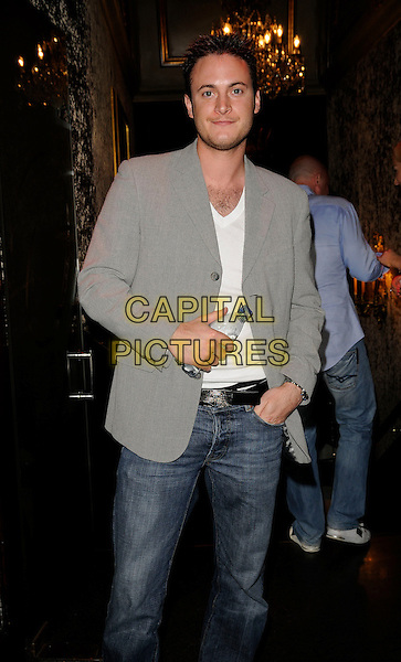 GARY LUCY.Miss Great Britain 2009 Grand Final,  Cafe de Paris, London, England. .May 12th, 2009 .half length grey gray suit jacket bottle water drink beverage .CAP/CAN.©Can Nguyen/Capital Pictures.