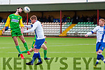 Sean Cournane of the Kerry DL team wins a header and clears the ball during Sunday's game against Limerick DL at Mounthawk Park.