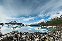 Summer landscape of shoreline and ice berg and Colony Glacier at Inner Lake George. Summer. Southcentral, Alaska.  Chugach Mountains. <br /> <br /> <br /> (C) Jeff Schultz/SchultzPhoto.com