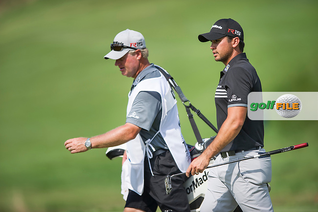 Jason Day (Aust) hugs his caddie, Col Swanton on their way  to winning the 2015 USPGA Championship at Whistling Straits (Photo: Anthony Powter)