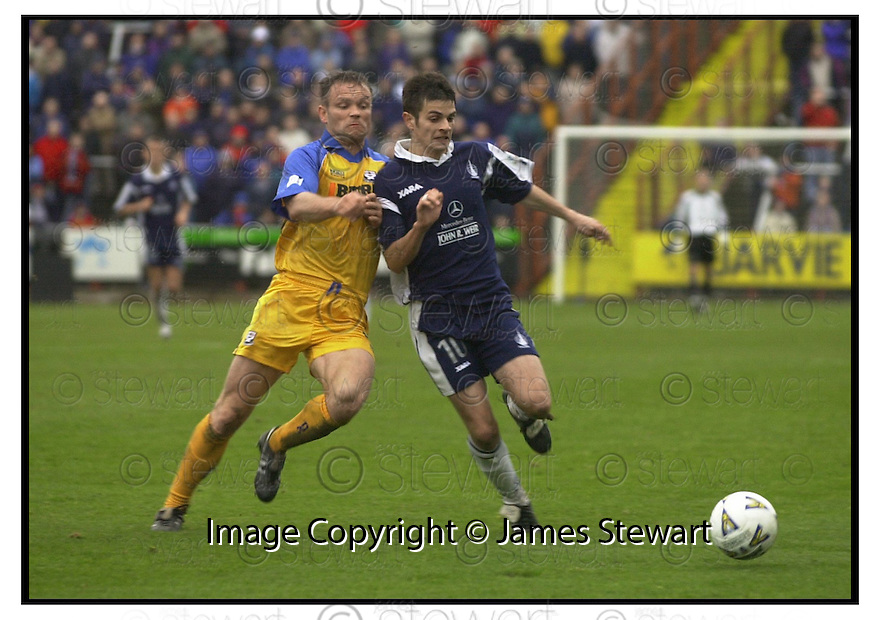 28th  October  2000      Copyright Pic : James Stewart .Ref :                           .File Name : stewart05-falkirk v ayr utd.STEVEN CRAIG HOLDS OFF AYR'S  JOHN HUGHES.....Payments to :-.James Stewart Photo Agency, Stewart House, Stewart Road, Falkirk. FK2 7AS      Vat Reg No. 607 6932 25.Office : +44 (0) 1324 630007        Mobile : 07721 416997.Fax     : +44 (0) 1324 630007.E-mail : jim@jspa.co.uk.If you require further information then contact Jim Stewart on any of the numbers above.........
