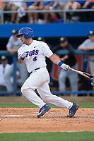 Mike Rivera (4) of the Florida Gators follows through on his swing against the Wake Forest Demon Deacons in Game One of the Gainesville Super Regional of the 2017 College World Series at Alfred McKethan Stadium at Perry Field on June 10, 2017 in Gainesville, Florida.  The Gators defeated the Demon Deacons 2-1 in 11 innings.  (Brian Westerholt/Four Seam Images)