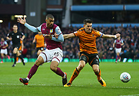 Danny Batth of Wolverhampton Wanderers and Lewis Grabban of Aston Villa challenge for the ball.<br /> <br /> Photographer Leila Coker/CameraSport<br /> <br /> The EFL Sky Bet Championship - Aston Villa v Wolverhampton Wanderers - Saturday 10th March 2018 - Villa Park - Birmingham<br /> <br /> World Copyright &copy; 2018 CameraSport. All rights reserved. 43 Linden Ave. Countesthorpe. Leicester. England. LE8 5PG - Tel: +44 (0) 116 277 4147 - admin@camerasport.com - www.camerasport.com