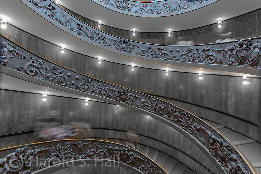 When exiting the mind numbing exhibits at the Vatican Museum and finally getting to see the famous Sistine Chapel, one finally exits via this wonderful spiral staircase. The visible blurs are others walking down the staircase.