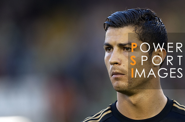 SANTANDER - SEPTEMBER 21:  Cristiano Ronaldo of Real Madrid looks on before the La Liga soccer match between Real Racing Club and Real Madrid at El Sardinero Stadium on September 21, 2011 in Santander, Spain. Photo by Victor Fraile / The Power of Sport Images
