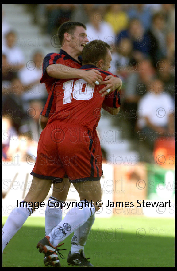 28th August 99                      Copyright Pic : James Stewart .Ref :                           .File Name : stewart07-dunfermline v falkirk                        .DAVID MOSS (10) IS CONGRATULATED BY GARETH HUTCHISON AFTER HE PUT FALKIRK INTO THE LEAD......Payments to :-.James Stewart Photo Agency, Stewart House, Stewart Road, Falkirk. FK2 7AS      Vat Reg No. 607 6932 25.Office : 01324 630007        Mobile : 0421 416997.E-mail : JSpics@aol.com.If you require further information then contact Jim Stewart on any of the numbers above.........