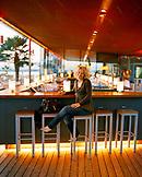 AUSTRIA, Neusiedl Am See, Silvia Schwischeil sitting at the Mole West outdoor bar, Burgenland