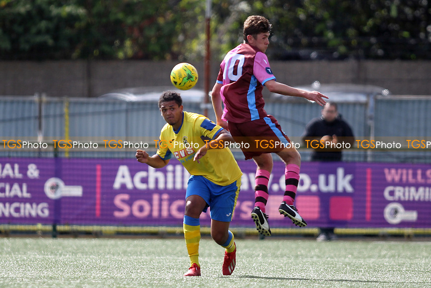 Coby Rowe of Haringey clears from Ollie Sitch of Corinthian during Haringey Borough vs Corinthian Casuals, BetVictor League Premier Division Football at Coles Park Stadium on 10th August 2019