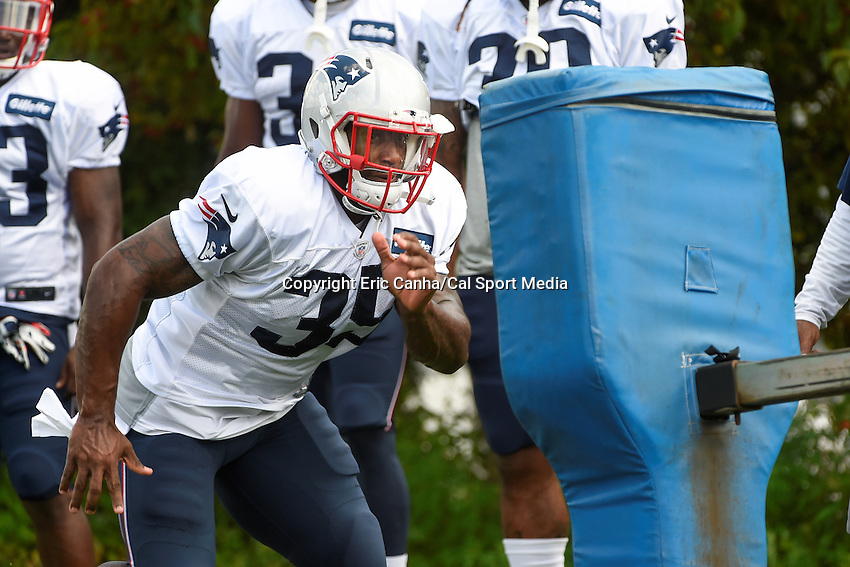 August 4, 2015: New England Patriots running back Jonas Gray (35) works on a tackle dummy during the New England Patriots training camp held on the practice field at Gillette Stadium, in Foxborough, Massachusetts. Eric Canha/CSM