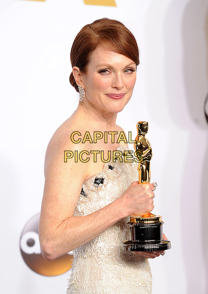 HOLLYWOOD, CA - FEBRUARY 22: Julianne Moore with the award for Best Actress in a Leading Role at the 87th Annual Academy Awards at the Dolby Theatre on February 22, 2015 in Hollywood, California. <br /> CAP/MPI/PGFM<br /> &copy;PGFM/MPI/Capital Pictures Oscars