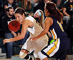 JANUARY 30, 2015 -- Chelsey Biegler #22 of Black Hills State drives on Caresse Williams #14 of Regis University during their Rocky Mountain Athletic Conference women's basketball game Friday evening at the Donald E. Young Center in Spearfish, S.D.  (Photo by Dick Carlson/Inertia)