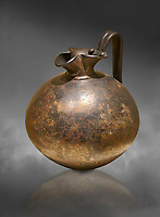 Phrygian bronze trefoil spouted jug from Gordion . Phrygian Collection, 8th century BC - Museum of Anatolian Civilisations Ankara. Turkey. Against a grey background