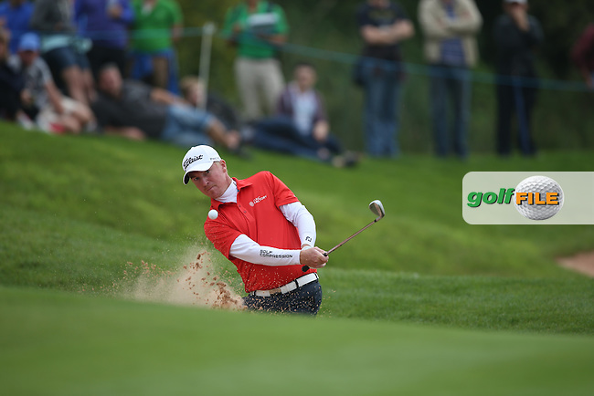 Controlled bunker shot for Patrik Sjoland (SWE) on the 14th and he makes par during Round Three of the ISPS Handa Wales Open 2014 from the Celtic Manor Resort, Newport, South Wales. Picture:  David Lloyd / www.golffile.ie
