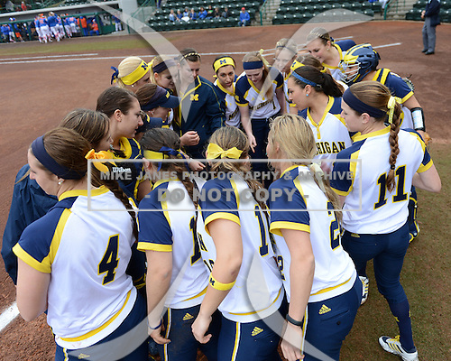 Michigan Wolverines team huddle before the season opener against the Florida Gators on February 8, 2014 at the USF Softball Stadium in Tampa, Florida.  Florida defeated Michigan 9-4 in extra innings.  (Copyright Mike Janes Photography)