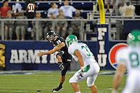 1 September 2011:  FIU kicker Jack Griffin (38) kicks off in the first half as the FIU Golden Panthers defeated the University of North Texas, 41-16, at University Park Stadium in Miami, Florida.