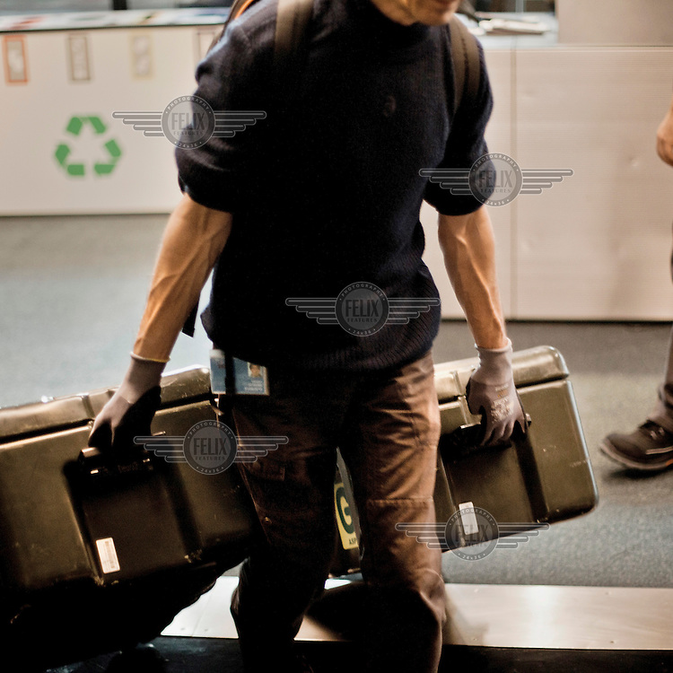 Christian Schramm, from the logistics section at the European Parliament, moves document containers, called 'cantines', that are used to transport documents between European Parliament sites in Brussels, Strasbourg and Luxembourg. Every month thousands of parliament's employees travel back and forth between the three sites of European government in Brussels, Strasbourg and Luxembourg, with their documents following them.