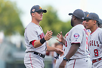 AFL East third baseman Bobby Dalbec (11), of the Mesa Solar Sox and Boston Red Sox organization, shakes hands with manager Tommy Watkins (8) during player introductions before the Arizona Fall League Fall Stars game at Surprise Stadium on November 3, 2018 in Surprise, Arizona. The AFL West defeated the AFL East 7-6 . (Zachary Lucy/Four Seam Images)