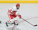MADISON, WI - SEPTEMBER 29: Jinelle Zaugg #8 of the Wisconsin Badgers women's hockey skates against the Quinnipiac Bobcats at the Kohl Center on September 29, 2006 in Madison, Wisconsin. The Badgers beat the Bobcats 3-0. (Photo by David Stluka)