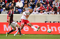 Thierry Henry (14) of the New York Red Bulls takes a shot. The New York Red Bulls defeated the Colorado Rapids 4-1 during a Major League Soccer (MLS) match at Red Bull Arena in Harrison, NJ, on March 25, 2012.
