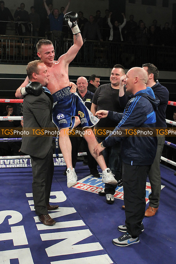 Frankie Gavin (blue shorts) defeats Junior Witter in a Welterweight boxing contest for the British Title at York Hall, Bethnal Green, London, promoted by Frank Warren - 02/11/12 - MANDATORY CREDIT: Gavin Ellis/TGSPHOTO - Self billing applies where appropriate - 0845 094 6026 - contact@tgsphoto.co.uk - NO UNPAID USE.