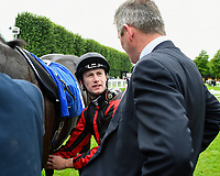 Jockey Oisin Murphy chats to trainer Joseph Tuite in the winners enclosure after winning the Peter Symonds Catering Handicap (Class 5),   during Afternoon Racing at Salisbury Racecourse on 7th August 2017